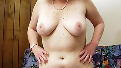 Mature milf playing with her jugs